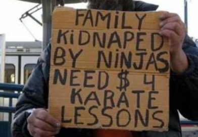 Homeless Man With Funny Sign Still Homeless