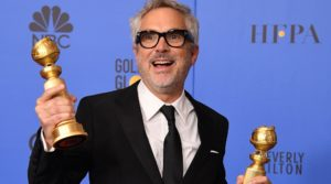 He's holding Golden Globes in this one, but we're pretty sure he got the Oscar too